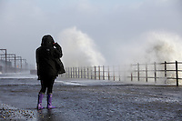 Martine Smith, 21, from Kilwinning pictured. Saltcoats Railway Station on the West Coast of Scotland, the UK, is hit by severe storms. 8 December 2011. Picture by Guy Hinks/Universal News and Sport (Europe)