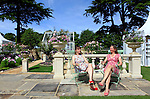 29/06/2015<br /> <br /> RHS Hampton Court Palace Flower Show prepares to open to the public.<br /> <br /> Designers Jean Wardrop and Alexandra Stevenson outside their A Growing Obsession - The Yardley London Perennial Garden, inspired by the works of Jane Louden.