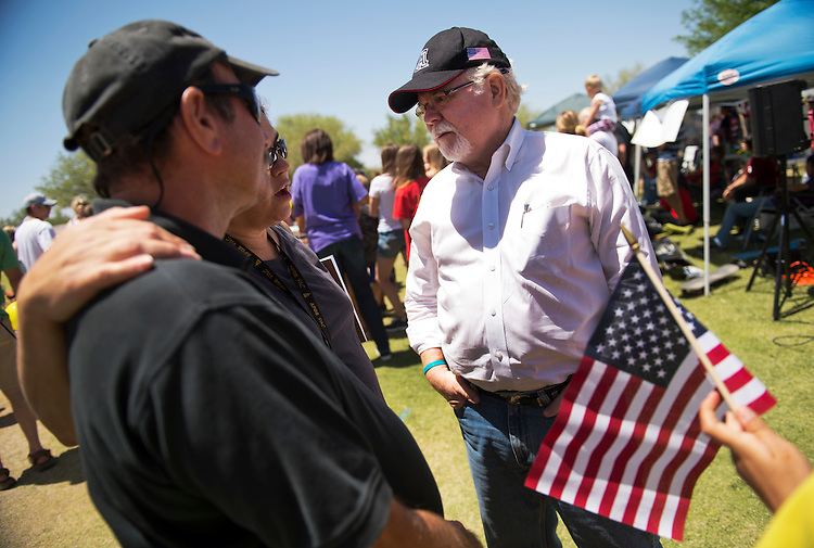 UNITED STATES - MAY 26:  Ron Barber, democratic contender in the AZ-08 special election, talks with attendees of the Rita Ranch Family Fun Day in Tucson, Ariz.  The winner of the election on June 12th will fill the seat occupied by former Rep. Gabrielle Giffords, D-Ariz.  (Photo By Tom Williams/CQ Roll Call)