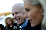 Sen. John McCain (R-AZ) gives an interview with wife Cindy after a campaign house party in Londonderry, NH, on Monday, Dec. 31, 2007.