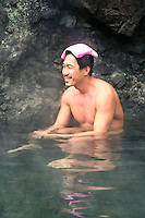 A Japanese man relaxing at an open air hot spring called a &quot;rotemburo&quot; in Japan.  Bathing in a natural atmosphere, among the trees and under open skies is a favorite with Japanese.  Nowadays it is almost a requirement for any hot spring resort to have outdoor baths thanks to their popularity.
