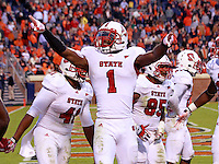 Oct. 22, 2011 - Charlottesville, Virginia - USA; North Carolina State Wolfpack cornerback David Amerson (1) celebrates a touchdown during an NCAA football game against the Virginia Cavaliers at the Scott Stadium. NC State defeated Virginia 28-14. (Credit Image: © Andrew Shurtleff