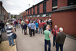 Rival fans gathering in the street for a drink outside the social club at Seaview Park, Belfast before Northern Irish club Crusaders take on Fulham in a UEFA Europa League 2nd qualifying round, fist leg match. The visitors from England won by 3 goals to 1 before a crowd of 3011.