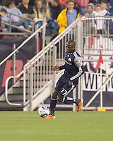 New England Revolution midfielder Sainey Nyassi (17) brings the ball forward. In a Major League Soccer (MLS) match, the New England Revolution tied the Colorado Rapids, 0-0, at Gillette Stadium on May 7, 2011.