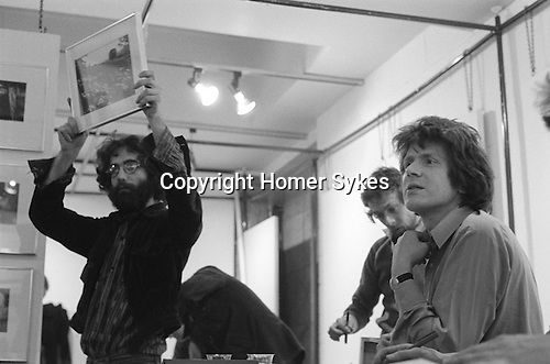 "The Photographers Gallery Great Newport Street London 1971. ""Co Optic"" Christmas Print Auction. Photographer Bob Mazzer, Gerry Badger and Stephen Weiss."