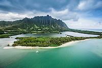 An aerial view of a fishpond and less-populated beach near Kualoa Valley, Windward O'ahu.