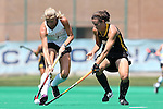 30 August 2014: Wake Forest's Jess Newak (3) and Iowa's Jessy Silfer (right). The Wake Forest University Demon Deacons played the University of Iowa Hawkeyes at Francis E. Henry Stadium in Chapel Hill, North Carolina as part of the ACC/Big 10 Challenge and an 2014 NCAA Division I Field Hockey match. Iowa won the game 4-1.