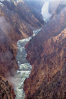 798600064 snow begins to fall on lower yellowstone falls in the grand canyon of the yellowstone in yellowstone national park wyoming