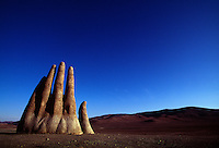 Fingers of a giant sculpted hand reach out of the relentless Atacama sands along the Pan American highway. The Mano de Desierto is a large-scale sculpture of a hand.  The art was funded by a local booster organization called Corporaci&oacute;n Pro Antofagasta and inaugurated on March 28, 1992.<br /> Constructed by the Chilean sculptor Mario Irarr&aacute;zabal, it has a base of iron and cement, and stands 11 meters tall. Besides sculptures and art, the desolate region south of Antofagasta, has geologic wonders of geysers and hot springs, volcanoes and saline lakes where flamingos breed.