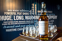 75cl bottle of 10 year old Talisker single malt Scotch Whisky and dram glasses for tasting (dramming) as part of the visitors tour at the Distillery in Carbost on Isle of Skye, Scotland