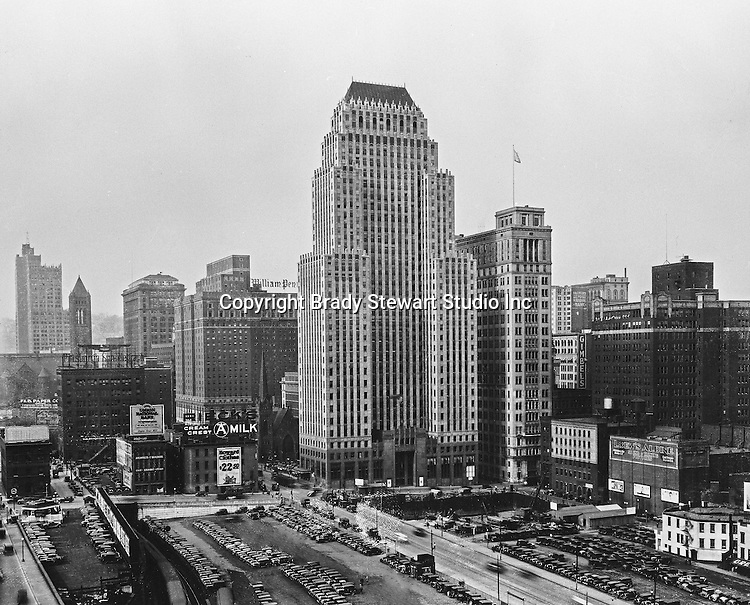 Pittsburgh PA:  Built in 1929, this is a view of the Koppers Building with the new Gulf Building construction site in foreground - 1930.  The new Grant Building is the background (far left)