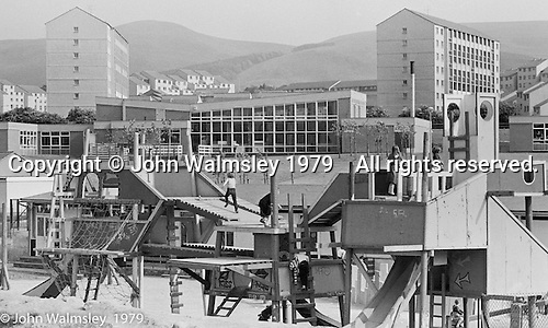 "The ""Venchie"" (adventure playground), Wester Hailes, Scotland, 1979.  John Walmsley was Photographer in Residence at the Education Centre for three weeks in 1979.  The Education Centre was, at the time, Scotland's largest purpose built community High School open all day every day for all ages from primary to adults.  The town of Wester Hailes, a few miles to the south west of Edinburgh, was built in the early 1970s mostly of blocks of flats and high rises."