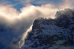 Sun and clouds on the Schreckhorn mountain - Swiss Alps