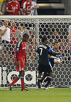 27 August 2011: San Jose Earthquakes forward Chris Wondolowski #8 scores the equalizer and grabs the ball out of the net during a game between the San Jose Earthquakes and Toronto FC at BMO Field in Toronto..The game ended in a 1-1 draw.