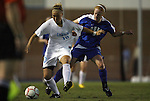 24 September 2009: North Carolina's Erin Mikula (10) has her jersey pulled by Duke's Rebecca Allen (right). The University of North Carolina Tar Heels defeated the Duke University Blue Devils 2-1 in sudden victory overtime at Fetzer Field in Chapel Hill, North Carolina in an NCAA Division I Women's college soccer game.