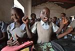 Girl students sing in class at the John Paul II School in Wau, South Sudan.