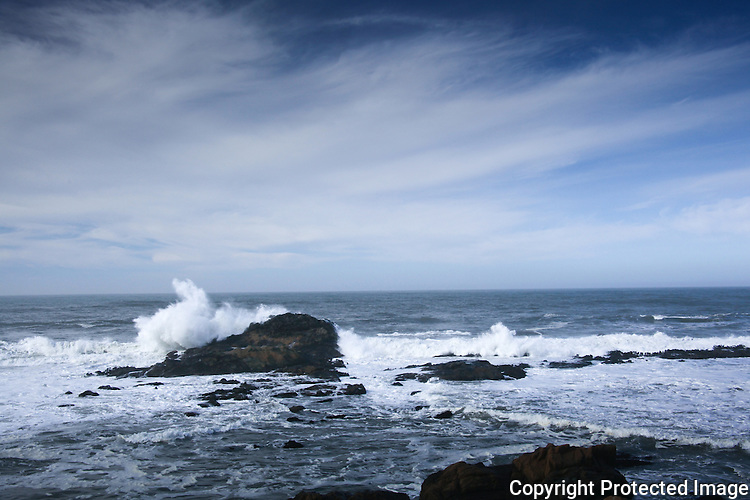 Waves crashing and waves rolling into the Pacific shoreline at Bean Hollow State Beach, CA.