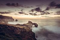 Dawn at Tunnel Beach, Coastal Otago, New Zealand - stock photo, canvas, fine art print