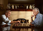 Two seniors enjoying a game of chess in the evening