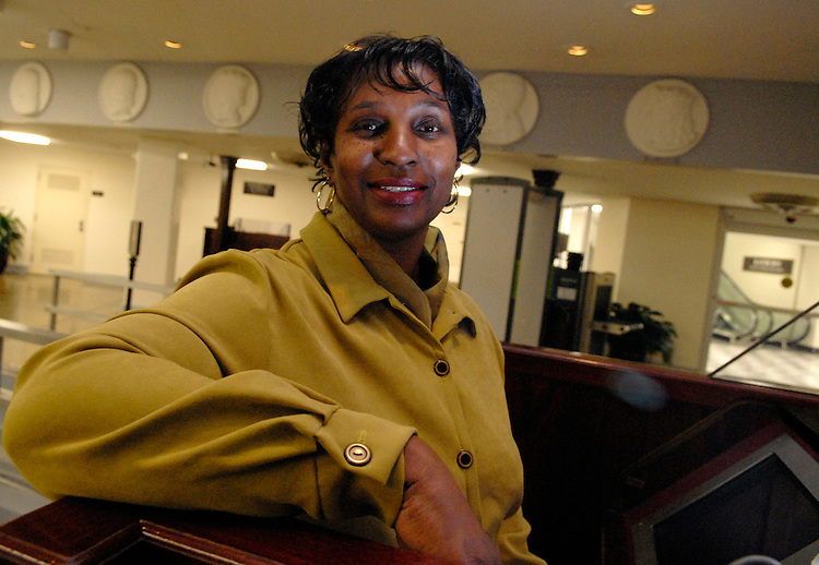 Arva Marie Johnson, who is retiring from the Capitol Police after 32 years, poses for a picture at her old post at the Rayburn subway.