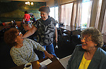 Connie Douglas (center) wishes Martha Holland a happy 76th birthday while she eats breakfast at The Purple Cow with her friend Earlene Johnson, October 2, 2010, in Beattyville, Kentucky.  Photo by David Foster
