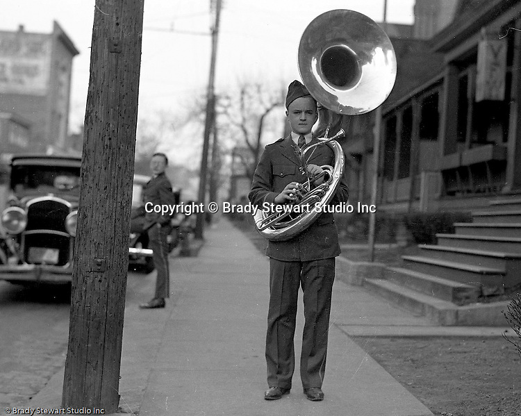 Wilkinsburg PA:  Brady Stewart Jr played the tuba in the Wilkinsburg High School Band.  View of him getting ready to go to a football in front of his house in Wilkinsburg - 1937