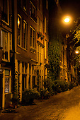 Amsterdam, Holland. An alley at night with the street lamps casting a eerie glow.