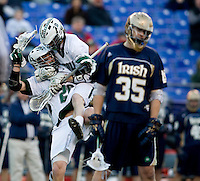 Stephen Murray (26) and Collin Finnerty (20) of Loyola celebrate a goal as Kevin Ridgway (35) of Notre Dame walks away during the Face-Off Classic in at M&T Stadium in Baltimore, MD