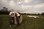 Photograph of Leicestershire farmers Jacob Sykes and Nick Ball with free-range, slow grown turkey, cockrel and geese at Fosse Meadow Farm, Frolesworth, Lutterworth, Leicestershire