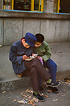 00045_13, CHINA-10054, Beijing, China, Monsoons, 1984. Two boys read a book. <br />