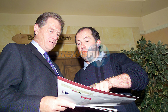 Auctioneer Raymond Potterton shows gerard Kerrigan the site map to the new 149 acre farm that he just purchased at auction for Û1320000 in the Ardboyne Hotel in Navan..Picture Fran Caffrey Newsfile...This Picture is sent to you by:..Newsfile Ltd.The View, Millmount Abbey, Drogheda, Co Louth, Ireland..Tel: +353419871240.Fax: +353419871260.GSM: +353862500958.ISDN: +353419871010.email: pictures@newsfile.ie.www.newsfile.ie