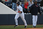 Ole Miss' Zack Kirksey (11) hits a home run vs. Memphis at Oxford University Stadium in Oxford, Miss. on Tuesday, February 22, 2011.