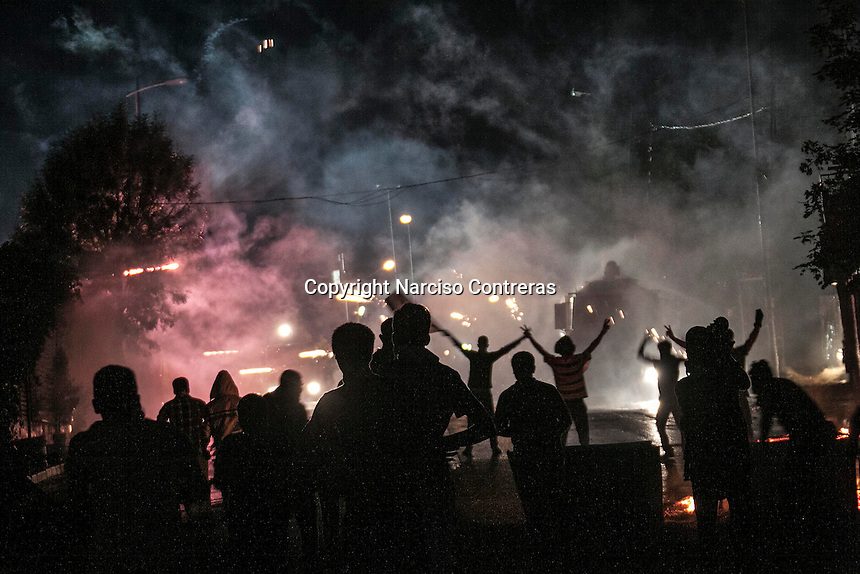 In this Sunday, Jun. 09, 2013 photo, protesters clash to the anti-riot police at the streets in Gazi Mahallesi neighbourhood, a suburb outskirst Istanbul where residents support the massive rally in Gazi park of Taksim Square, Turkey. (Photo/Narciso Contreras).