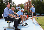 30 August 2009: North Carolina head coach Anson Dorrance (left) with (from left) assistant coaches Bill Palladino, Chris Ducar, and Cindy Parlow. The University of North Carolina Tar Heels defeated the University of North Carolina Greensboro Spartans 1-0 at Fetzer Field in Chapel Hill, North Carolina in an NCAA Division I Women's college soccer game.