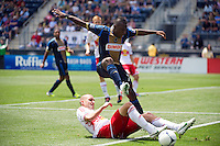 Freddy Adu (11) of the Philadelphia Union jumps over a challenge by Brandon Barklage (25) of the New York Red Bulls during a Major League Soccer (MLS) match at PPL Park in Chester, PA, on May 13, 2012.