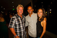 HONOLULU, Oahu, Turtle Bay Resort. Thursday 6th 2012. Gary Kong Elkerton (AUS), Kelly Slater (USA) and Kelly's girfriend Kalani Miller (USA). .Since moving the show to Oahu's North Shore three years ago, the 2012 SURFER Poll saw its largest turn out ever. From surfing's best to local legends, the packed house witnessed another historic night, as Kelly Slater (USA) and Stephanie Gilmore (AUS) won this year's Men's and Women's Polls. Gabriel Medina (BRA) won the Andy Irons Break Out Performer of the year award and finished #4 on the Surfer Poll while Dane Reynolds (USA) picked up two awards as well. Photo: joliphotos.com