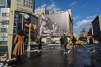 A Calvin Klein underwear billboard in the Soho neighborhood of New York features model/musician Justin Bieber with model Lara Stone on Friday, January 9, 2015. The ads featuring Bieber, the new face of the brand, are imitating the iconic Mark Wahlberg Calvin Klein advertisements from the early 1990's.  (© Richard B. Levine)