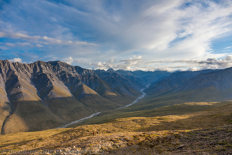 Hikers in the Brooks range mountains bordering the west side of the Marsh Fork of the Canning river in the Arctic National Wildlife Refuge in the Brooks range mountains, Alaska.