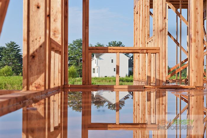 Rain soaked Wood Framed House Under Construction