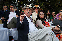 Australia's High Commissioner to India, Dr. Lachlan Strahan (front left) and Princess Diya Kumari of Jaipur (front right) watch the game, from the upper pavilion, between the Royal Jaipur Polo Team and the Western Australia Polo Team for the Argyle Pink Diamond Cup, organised as part of the 2013 Oz Fest in the Rajasthan Polo Club grounds in Jaipur, Rajasthan, India on 10th January 2013. Photo by Suzanne Lee