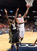 CHARLOTTESVILLE, VA- DECEMBER 6: Mike Scott #23 of the Virginia Cavaliers shoots in front of Mike Morrison #22 of the George Mason Patriots during the game on December 6, 2011 at the John Paul Jones Arena in Charlottesville, Virginia. Virginia defeated George Mason 68-48. (Photo by Andrew Shurtleff/Getty Images) *** Local Caption *** Mike Scott;Mike Morrison