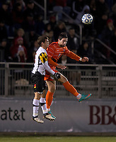 Manolo Sanchez (8) of Clemson goes up for a header with Mikey Ambrose (5) of Maryland during the game at the Maryland SoccerPlex in Germantown, MD. Maryland defeated Clemson, 1-0, in overtime.  With the win the Terrapins advanced to the finals of the ACC men's soccer tournament.