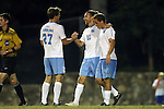 28 October 2014: North Carolina's Andy Craven (10) celebrates his hat trick with Nick Williams (27) and Tyler Engel (right). The University of North Carolina Tar Heels hosted the Georgia Southern University Eagles at Fetzer Field in Chapel Hill, NC in a 2014 NCAA Division I Men's Soccer match. North Carolina won the game 6-2.
