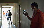Mohammed Adnan talks with his mother, Fripat Bibi, on Skype from a government-run refugee center in Vamosszabadi, Hungary. Hungarian Interchurch Aid, a member of the ACT Alliance, provides child care and other services to residents in the center, who come from Syria, Iraq and other countries and are bound for western Europe. Adnan's mother is in Pakistan, which he left to seek employment in Europe.