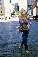 Laughing woman walking in street