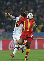 Teammates at French side, Rennes, U.S. defender Carlos Bocanegra and Ghana forward Asamoah Gyan compete for a long service. Gyan would win the battle scoring Ghana's winning goal in the third minute of extra time. Ghana defeated the U.S., 2-1, in extra time to advance to the quarterfinals, Saturday, June 26th, at the 2010 FIFA World Cup in South Africa..