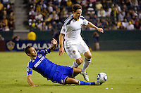 Kansas City Wizard midfielder Davy Arnaud attempts a tackle on LA Galaxy defender Todd Dunivant. The Kansas City Wizards beat the LA Galaxy 2-0 at Home Depot Center stadium in Carson, California on Saturday August 28, 2010.
