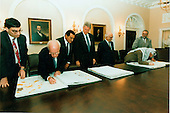 """Israeli and Palestinian leaders sign the maps that were part of the """"Oslo 2"""" agreement on 28 September, 1995.  This part of the signing took place in the Cabinet Room at the White House. (L-R) Unidentified Israeli; Israeli Prime Minister Yitzak Rabin; Egyptian President Hosni Mubarak; U.S. President Bill Clinton; King Hussein of Jordan; Palestinian Authority Chairman Yassir Arafat; and unidentified Palestinian..Mandatory Credit: Barbara Kinney - White House via CNP."""