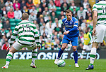 Celtic v St Johnstone....01.04.12   SPL.Jody Morris closed down by Kris Commons.Picture by Graeme Hart..Copyright Perthshire Picture Agency.Tel: 01738 623350  Mobile: 07990 594431