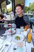 Vienna, Austria. Steirereck breakfast at the Meierei im Stadtpark.<br /> Marinierte Beeren mit Baiser &amp; Passionsfrucht (Marinated Berries with Meringue and Passionfruit), Beinschinken mit Kren &amp; Weizenknusper (Gammon Ham with Fresh Horseradish &amp; Panini), Bauern&ndash;Ei im Glas mit Rahm &amp; gehobelter G&auml;nseleber (Soft&ndash;Boiled Egg with Sour Cream &amp; Foie Gras), Saiblings&ndash;Tatare mit Sprossensalat (Char Tartare with Bean Sprouts and Black Radish)